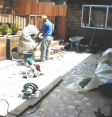Cutting bricks for a custom paver patio
