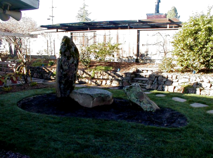 After- Boulders, Pavers, New Sod & Rock Retaining Wall